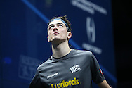Joe Lee of England (in the grey shirt) looks at the ceiling. Canary Wharf Squash Classic 2016 , day two at the East Wintergarden in Canary Wharf , London on Tuesday 8th March 2016.<br /> pic by John Patrick Fletcher, Andrew Orchard sports photography.
