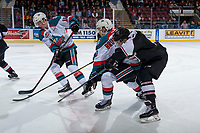KELOWNA, CANADA - MARCH 7: Aidan Barfoot #21 of the Vancouver Giants stick checks Conner Bruggen-Cate #20 of the Kelowna Rockets on March 7, 2018 at Prospera Place in Kelowna, British Columbia, Canada.  (Photo by Marissa Baecker/Shoot the Breeze)  *** Local Caption ***