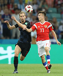 SOCHI, July 7, 2018  Aleksandr Golovin (R) of Russia vies with Ivan Strinic of Croatia during the 2018 FIFA World Cup quarter-final match between Russia and Croatia in Sochi, Russia, July 7, 2018. (Credit Image: © Xu Zijian/Xinhua via ZUMA Wire)