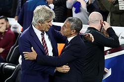 West Ham United manager Manuel Pellegrini (left) and Brighton & Hove Albion manager Chris Hughton during the Premier League match at the AMEX Stadium, Brighton.