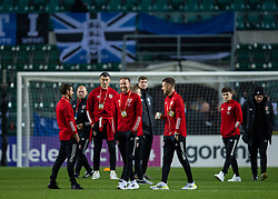 TALLINN, ESTONIA - Monday, October 11, 2021: Wales' Chris Gunter (C) on the pitch with team-mates Joe Allen (L) and captain Aaron Ramsey (R) before the FIFA World Cup Qatar 2022 Qualifying Group E match between Estonia and Wales at the A. Le Coq Arena. Wales won 1-0. (Pic by David Rawcliffe/Propaganda)
