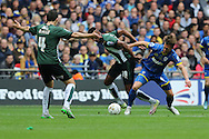 Dannie Bulman midfielder of AFC Wimbledon (4) and Plymouth Argyle striker Jamille Matt (19) tussle during the Sky Bet League 2 play off final match between AFC Wimbledon and Plymouth Argyle at Wembley Stadium, London, England on 30 May 2016. Photo by Stuart Butcher.