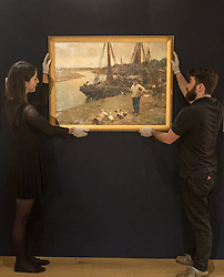 Bonhams, London, February 22nd 2017. Bonhams in London hold a press preview ahead of their 19th century paintings sale, featuring numerous valuable works including:<br /> • 'Children by the shore' by Dorothea Sharp, valued at £60,000-80,000<br /> • Barcas y pescaadores, Playa de Valencia by Joaquin Sorolla £60,000-80,000<br /> • When the Boats Come In by Walter Osborne valued at £100,000-150,000<br /> • A Solicitation by Lawrence Alma-Tadema which is expected to fetch between £30,000-50,000<br /> PICTURED: Gallery staff hang When the Boats Come In by Walter Osborne