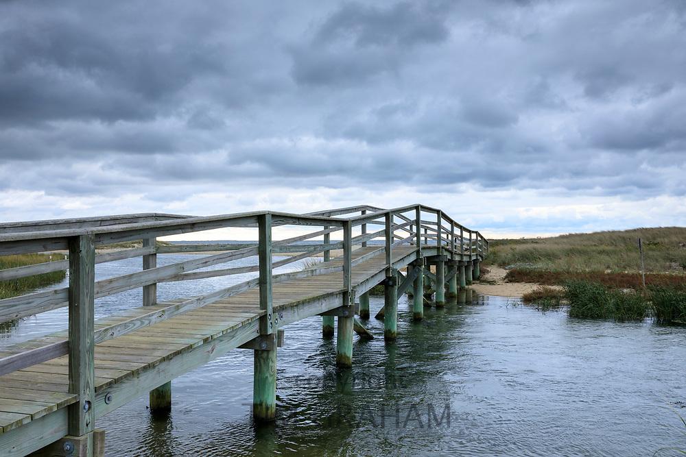 Wooden footbridge walkway at Ridgevale Beach, Nantucket Sound, Cape Cod, New England, USA