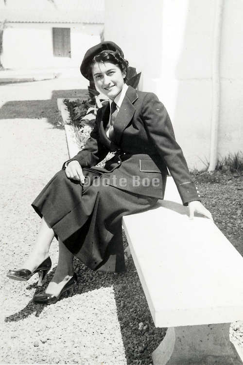 woman sitting on a bench 1953 France