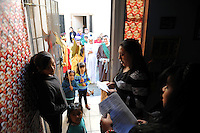 From inside a home at Acosta Plaza, innkeepers and pilgrims exchange symbolic verses on Thursday in Salinas. The event recreates the search of Mary and Joseph for shelter during their journey from Nazareth to Bethlehem.