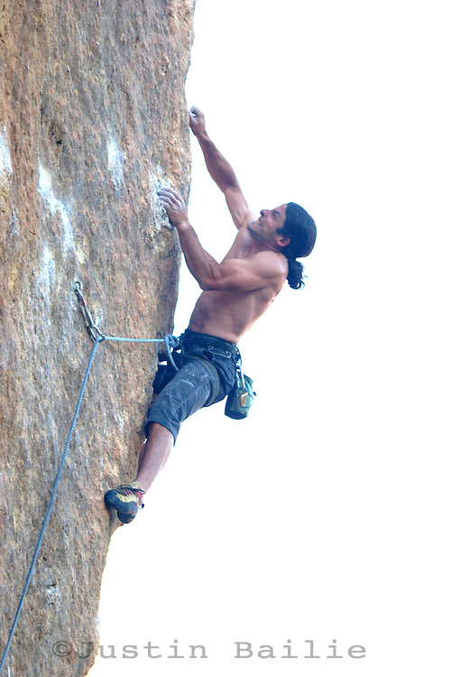 Man climbing 5.13+ at Smith Rocks, OR