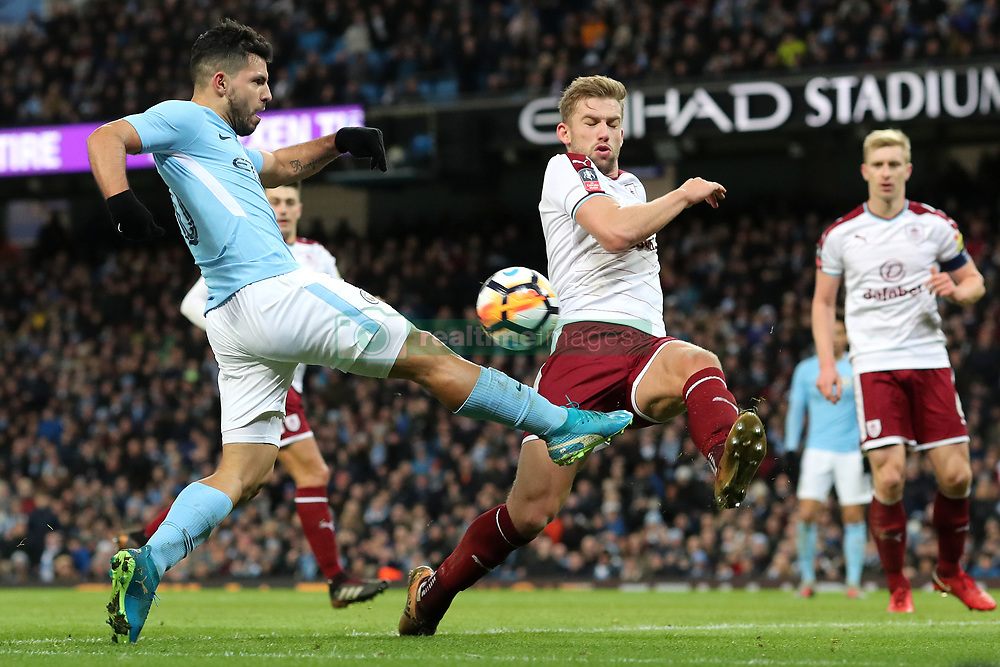6 January 2018 - FA Cup (3rd Round) Football - Manchester City v Burnley - Charlie Taylor of Burnley blocks the shot of Sergio Aguero of Man City - Photo: Charlotte Wilson / Offside
