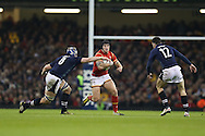 Tom James of Wales breaks away from David Denton of Scotland (l). RBS Six nations championship 2016, Wales v Scotland at the Principality Stadium in Cardiff, South Wales on Saturday 13th February 2016. <br /> pic by  Andrew Orchard, Andrew Orchard sports photography.