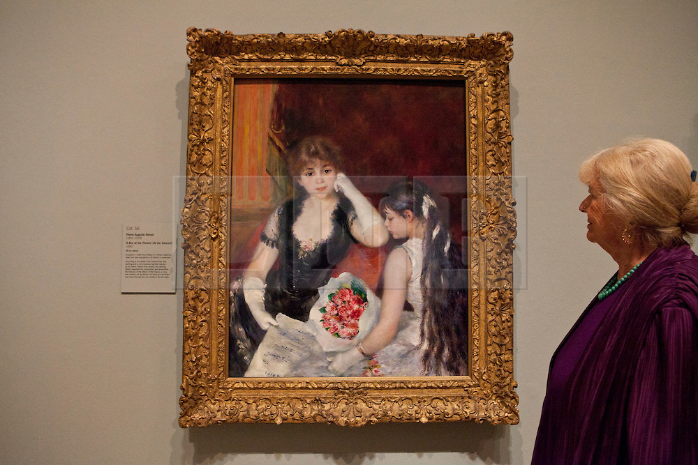 © under license to London News Pictures. 25/06/12. London, UK. Granddaughter of Francine Clark, Mrs Javotte Ray stands by the famous paining, A Box at the Theatre,1880, by Pierre-Auguste Renoir. The exhibition takes place at the Royal Academy of Arts. From Paris: A Taste of Impressionism - paintings from the Clark exhibition. The exhibition showcases seventy major works, many of which have never been on public display in the U.K before...ALEX CHRISTOFIDES/LNP