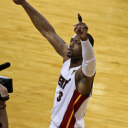 Jun 21, 2012; Miami, FL, USA; Miami Heat shooting guard Dwyane Wade (3) signals to the crowd prior to tip off of game five in the 2012 NBA Finals at the American Airlines Arena. Mandatory Credit: Derick E. Hingle-US PRESSWIRE