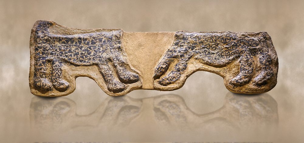 painted leopard relief. The people of Catalhoyuk had a special religious meaning with leopards. These platered reliefs have many coats of plater indicating their long term importance. 6000 BC,  Catalhoyuk Collections. Museum of Anatolian Civilisations, Ankara .<br /> <br /> If you prefer you can also buy from our ALAMY PHOTO LIBRARY  Collection visit : https://www.alamy.com/portfolio/paul-williams-funkystock/prehistoric-neolithic-art.html - Type Catalhoyuk into the LOWER SEARCH WITHIN GALLERY box. Refine search by adding background colour, place, museum etc.<br /> <br /> Visit our PREHISTORIC PLACES PHOTO COLLECTIONS for more  photos to download or buy as prints https://funkystock.photoshelter.com/gallery-collection/Prehistoric-Neolithic-Sites-Art-Artefacts-Pictures-Photos/C0000tfxw63zrUT4