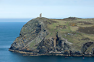 Kayaks rounding Bradda Head with the Milner's Tower above, near Port Erin. Hiking the Raad ny Foillan coastal path or 'Way of the Gull', Isle of Man © Rudolf Abraham