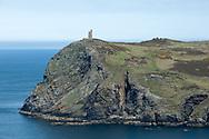 Kayaks rounding Bradda Head with the Milner's Tower above, near Port Erin. Hiking the Raad ny Foillan coastal path or 'Way of the Gull', Isle of Man © Rudolf Abraham