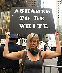 August 14, 2017 - New York, New York, U.S. - An anti-Trump protester reacts to the Charlottesville violence by Nazi white supremacists, outside of Trump Tower ahead the President's arrival. (Credit Image: © Nancy Kaszerman via ZUMA Wire)