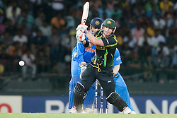 © Licensed to London News Pictures. 28/09/2012. Australian batsmen David Warner batting during the T20 Cricket World cup match between Australia Vs India at the R.Premadasa Cricket Stadium,Colombo. Photo credit : Asanka Brendon Ratnayake/LNP
