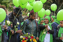 © Licensed to London News Pictures. 14/06/2019. London, UK.  Survivors, family and friends of the victims wearing symbolic green release green balloons to commemorate the second anniversary of the Grenfell Tower fire. On 14 June 2017, just before 1:00 am a fire broke out in the kitchen of the fourth floor flat at the 24-storey residential tower block in North Kensington, West London, which took the lives of 72 people. More than 70 others were injured and 223 people escaped. Photo credit: Dinendra Haria/LNP
