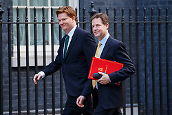 © licensed to London News Pictures. London, UK 18/03/2015. Treasury Secretary Danny Alexander and Deputy Prime Minister Nick Clegg attending to a cabinet meeting in Downing Street on the Budget Day, Wednesday, 18 March 2015. Photo credit: Tolga Akmen/LNP