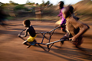 Children play outside the Boma Hospital.