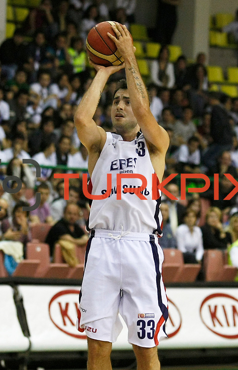 Efes Pilsen's Ender ARSLAN during their Turkish Basketball league Play Off Final first leg match Efes Pilsen between Fenerbahce Ulker at the Ayhan Sahenk Arena in Istanbul Turkey on Thursday 20 May 2010. Photo by Aykut AKICI/TURKPIX