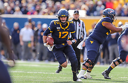 Nov 9, 2019; Morgantown, WV, USA; West Virginia Mountaineers quarterback Austin Kendall (12) runs the ball during the first quarter against the Texas Tech Red Raiders at Mountaineer Field at Milan Puskar Stadium. Mandatory Credit: Ben Queen-USA TODAY Sports