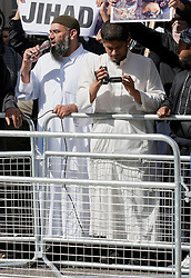 © London News Pictures. Anjem Choudary (L) and Siddhartha Dhar (C using camera) at a Muslims Against Crusades demonstration outside the American Embassy in Grosvenor Square on the tenth anniversary of the 9/11 attacks in London on September 11, 2011. There has been speculation that Siddhartha Dhar is this the new 'Jihadi John', who appeared in a recent ISIS video. Photo credit: LNP