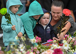 CHRISTCHURCH, March 17, 2019  People place flowers to mourn the victims of the attacks on two mosques in Christchurch, New Zealand, on March 17, 2019. The death toll from the terror attacks on two mosques in New Zealand's Christchurch has risen to 50 as one more victim was found at one of the shooting scenes, the police said on Sunday. (Credit Image: © Xinhua via ZUMA Wire)