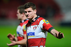 Gloucester Fly-Half (#10) Freddie Burns gives a subdued wave to supporters after his sides12-18 loss during the match - Photo mandatory by-line: Rogan Thomson/JMP - Tel: Mobile: 07966 386802 05/01/2013 - SPORT - RUGBY - Kingsholm Stadium - Gloucester. Gloucester Rugby v London Irish - Aviva Premiership.