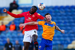 Toumani Diagouraga of Morecambe and Ollie Clarke of Mansfield Town jump to head the ball - Mandatory by-line: Ryan Crockett/JMP - 27/02/2021 - FOOTBALL - One Call Stadium - Mansfield, England - Mansfield Town v Morecambe - Sky Bet League Two