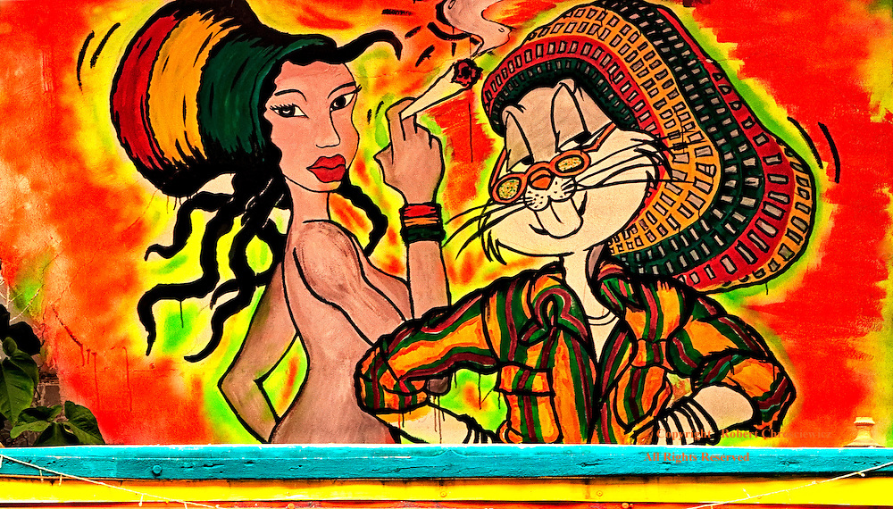 Bugs &  A Smokin' Friend: A local bar is adorned with a very colourful painting of Bugs Bunny and a naked lady,  both dressed in Rastafarian attire and the lady is smoking a reefer, Chiang Rai Thailand.