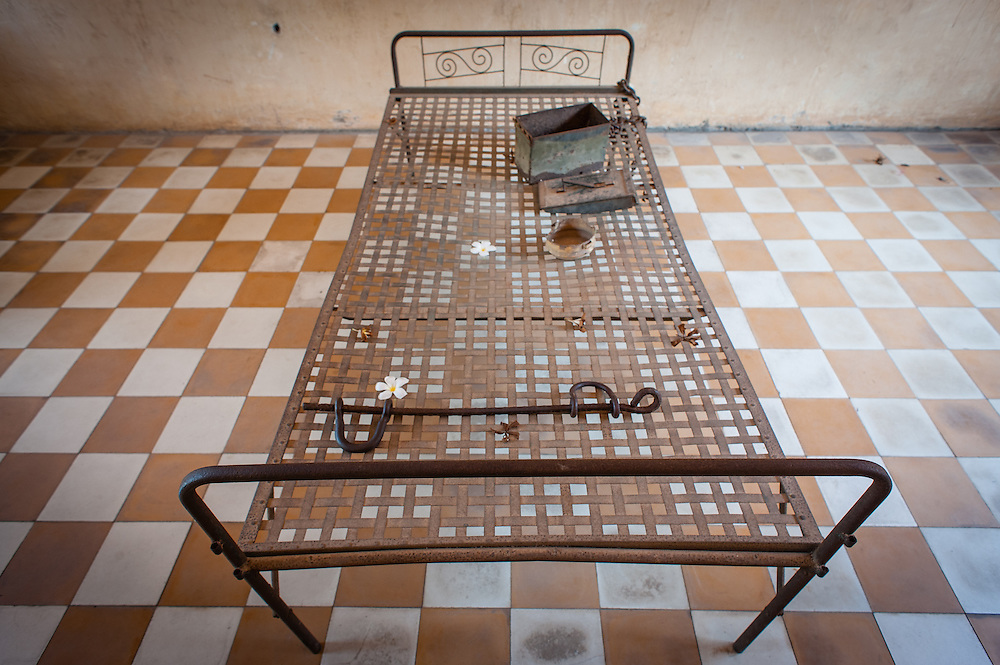 Bed in torture cell at Tuol Sleng Khmer Rouge Prison in Phnom Penh (Cambodia).