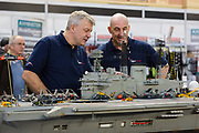 Dave Fortey L tends to his model of HMS Ark Royal R09 with a colleague at the London Model Engineering Exhibition at Alexandra Palace on January 1st, 2018. Mr Fortey, a former Royal Navy mechanic and sub-lieutenant, built the model over 25 years and it is the first time it has been put on display to the public. This week, the Government has launched a campaign to inspire the next generation. The Year of Engineering, will see government and industry tackle a major skills gap and inspire the engineers of tomorrow.