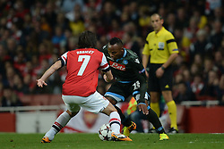 LONDON, ENGLAND - Oct 01: Arsenal's midfielder Tomas Rosicky from The Czech Republic  and Napoli's defender Camilo Zuniga from Columbia during the UEFA Champions League match between Arsenal from England and Napoli from Italy played at The Emirates Stadium, on October 01, 2013 in London, England. (Photo by Mitchell Gunn/ESPA)