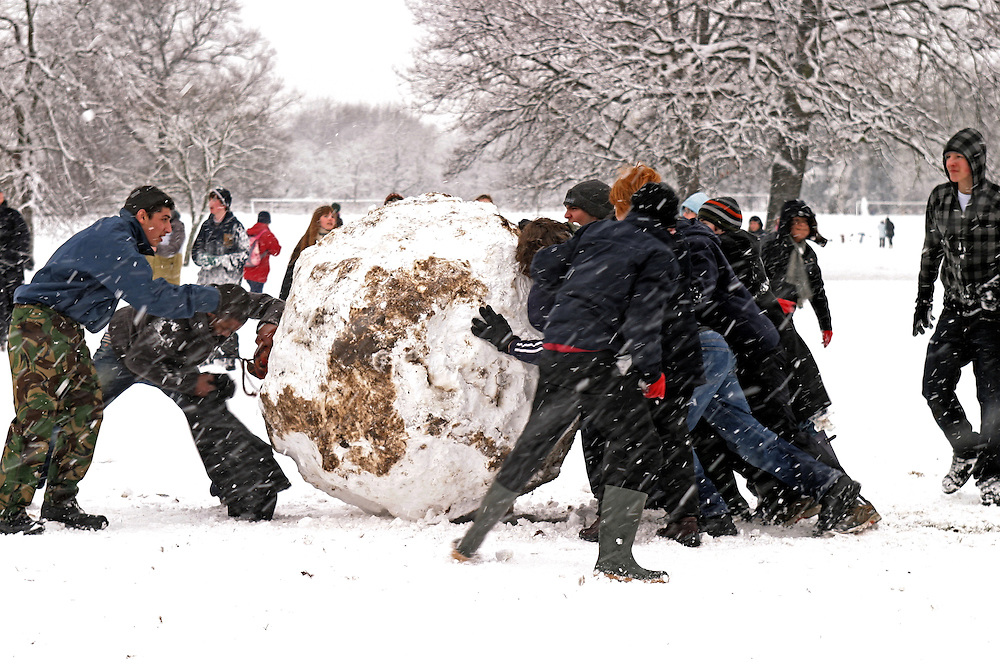 School children making giant snow ball. Dulwich Park London