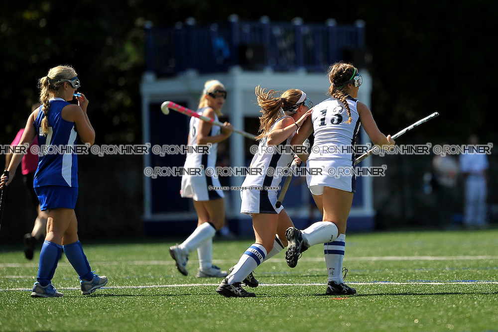 Staples High School Field Hockey..Westport defeats Hall 2-1 in final seconds of the game..Callie Hiner (SR)(C) and Misha Strage (SR)(C) celebrate after Strage scores the first of her two goals.