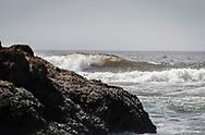 A wave rolls along the Oregon coast.