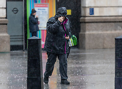 © Licensed to London News Pictures. 29/01/2021. London, UK. As the Met Office issue weather warnings for snow and rain for parts of the UK, commuters brave the heavy downpours in Westminster, London this morning. The Met office has issued weather warnings for much of the UK this weekend for snow, torrential rain and flooding with disruption to travel as the stormy weather continues. Photo credit: Alex Lentati/LNP