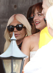 EXCLUSIVE: Dakota Johnson and Tilda Swinton seen in a boat in the rain in Venice. 01 Sep 2018 Pictured: Dakota Johnson, Tilda Swinton, Donatella Versace. Photo credit: AMA / MEGA TheMegaAgency.com +1 888 505 6342