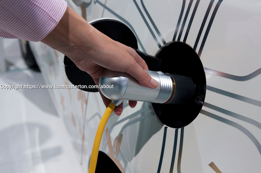 Recharging concept Toyota electric car using plug in charger at Frankfurt Motor Show 2009