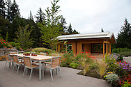 The view of the dining area by the outdoor fireplace and the yoga pavilion which was designed by architect Michael McCulloch