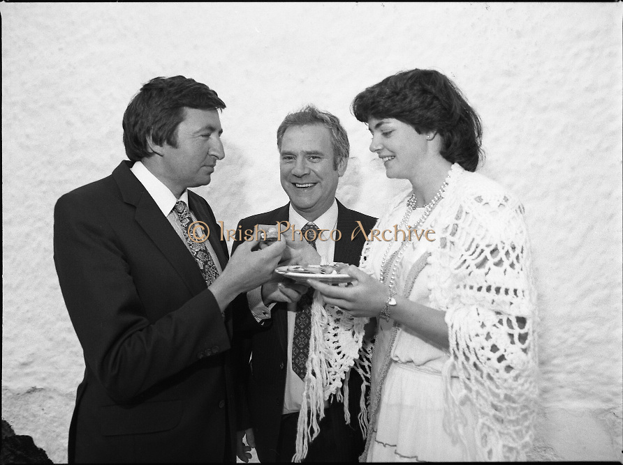 """The Carlingford Oyster Festival.1982.19.08.1982..08.19.1982.19th August 1982..Pictures and Images of the Carlingford Oyster Festival... The Minister For Fisheries and Forestry Mr Brendan Daly officially opened  The Carlingford Oyster Festival. The Chairman of the organising committee was Mr. Joe McKevitt..""""The Oyster Pearl"""" was Ms Deirdre McGrath..The Minister is encouraged to try an oyster himself..."""