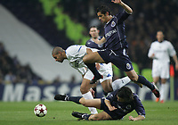 """PORTUGAL - PORTO 23 FEBRUARY 2005: RIBEIRO ADRIANO LEITE #10 (L), RICARDO COSTA Moreira #5 (A) and """"MANICHE"""" Nuno Ricardo Oliveira Ribeiro #18 compete for the ball, First Knock-out Round First Leg of the UEFA Champions League, match FC Porto (1) vs FC Internazionale (1), held in """"Dragao"""" stadium  23/02/2005  19:50:13<br />(PHOTO BY: NUNO ALEGRIA/AFCD)<br /><br />PORTUGAL OUT, PARTNER COUNTRY ONLY, ARCHIVE OUT, EDITORIAL USE ONLY, CREDIT LINE IS MANDATORY AFCD-PHOTO AGENCY 2004 © ALL RIGHTS RESERVED"""