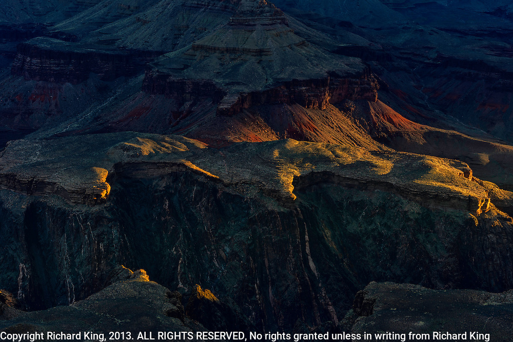 Grand Canyon Mesas painted with first golden light.  Fine art print for sale or licensed use