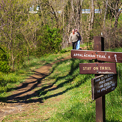 Hikers approach a sign along the Appalachian Trail in Washington County, MD.
