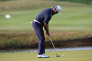 Graeme McDowell (NIR) makes par on the last for a round of 72 during (recommenced) Round One of the 2015 Alstom Open de France, played at Le Golf National, Saint-Quentin-En-Yvelines, Paris, France. /03/07/2015/. Picture: Golffile | David Lloyd<br /> <br /> All photos usage must carry mandatory copyright credit (© Golffile | David Lloyd)
