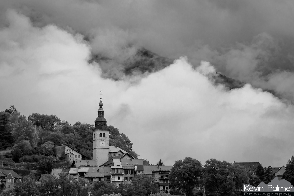 Clouds drift past the medieval village of Conflans in Albertville, France, as a storm clears.
