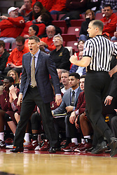 06 January 2016: Porter Moser shows some motions and some sideline antics as Jeff Malham travels the floor during the Illinois State Redbirds v Loyola-Chicago Ramblers at Redbird Arena in Normal Illinois (Photo by Alan Look)