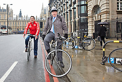 © Licensed to London News Pictures.  07/03/2013. LONDON, UK. Mayor of London BORIS JOHNSON (pictured right) and Olympic gold medal winning cyclist CHRIS  BOARDMAN (pictured left) cycle across Westminster Bridge and down the Embankment. The pair are launching a £913m vision for a cross London cycle lane including a dedicated space on the A40. Photo credit :  Cliff Hide/LNP
