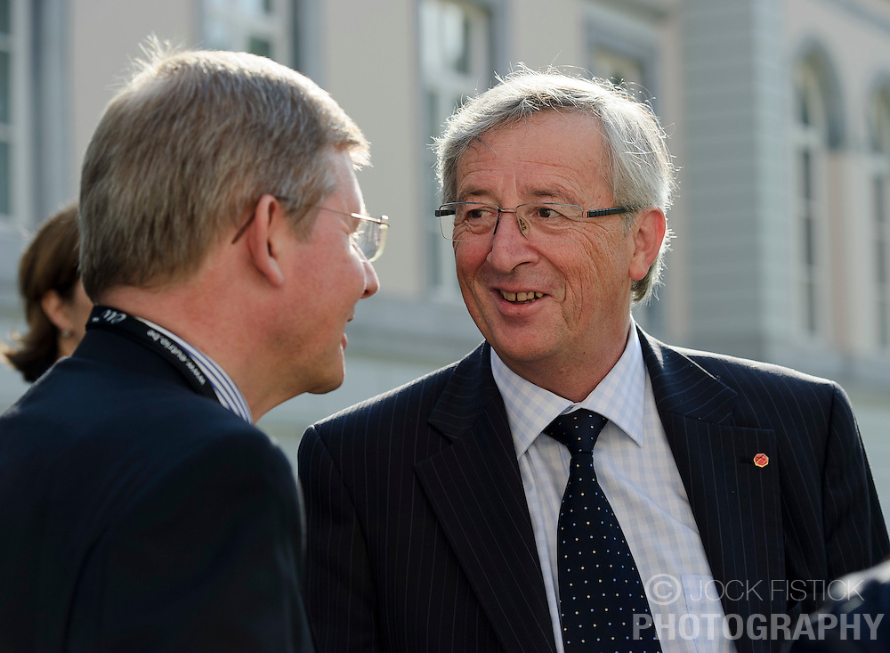 Jean-Claude Juncker, Luxembourg's prime minister, and president of the Eurogroup, right, speaks with Lucien Michels, spokesperson for the Luxembourg finance minister, during the Eurogroup finance ministers meeting in Brussels, Thursday Sept. 30, 2010. (Photo © Jock Fistick)