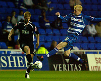 Photo: Daniel Hambury.<br /> Reading v Swansea. Carling Cup.<br /> 23/08/2005.<br /> Reading's Dave Kitson and Swansea's Alan Taite.